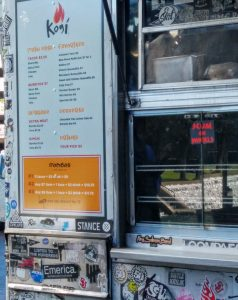 This Kogi Truck is plastered in a variety of stickers, covering most of the service side and back end.